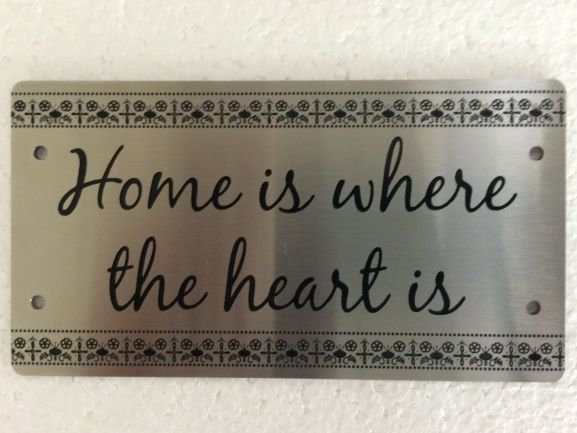 Stainless Steel Home is Laser Engraved NSW